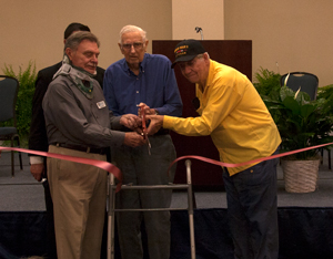 World War II veterans Alex Moskowitz and Julian Odom help cut the ribbon at the new Brunswick Center at Supply.